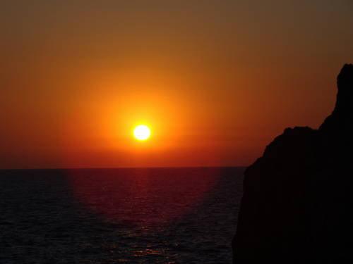 Pôr do sol no beach club Lido del Faro